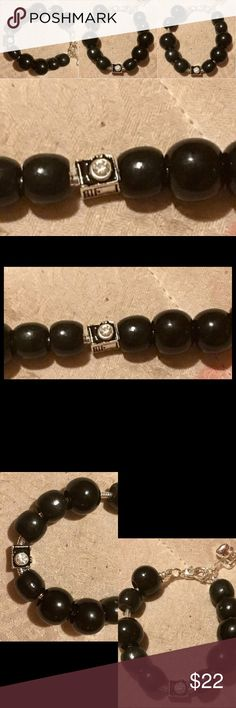 10 black wooden beads plus camera charm. TV$30 5 black wooden beads, the camera charm, then 5 more black wooden beads handmade Accessories
