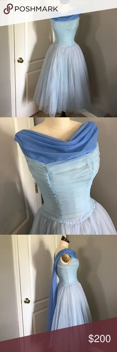 1950's Vintage Princess dress! stunning! size 2 Rare Beauty!! This Dress is a true vintage 1950's dress! Fits like a size 2 today. Looks like a real Disney Princess dress! Two tone blue. A Real Stunner! Has small hole as pictured in on of the skirts layers, and some staining inside the dress lining as pictured. But again it's 67 years old, so great condition considering! Be sure to bundle to save! ;) vintage  Dresses Midi