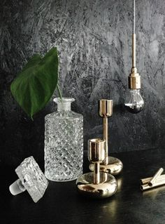 Crystal, black painted particle board + brass fixtures