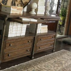 Really unique console table. I really like it. Great style/color.
