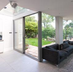 A Frameless Glass Corner Window, Sliding Aluminium Doors And Glass Roof