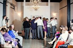 Bride and groom and family praying during the ceremony picture at Elizabeth Claires by Amanda May Photos