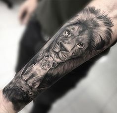 Lions tattoo by Nelson! Limited availability at Revival Tattoo Studio! Half Sleeve Tattoos Lower Arm, Half Sleeve Tattoos Color, Half Sleeve Tattoos Drawings, Unique Half Sleeve Tattoos, Half Sleeve Tattoos Designs, Full Sleeve Tattoos, Tattoo Designs, Lions Tattoo, Lion Cub Tattoo