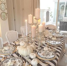 The black and white striped tablecloth amps up the more subdued table setting. Very nicely done.