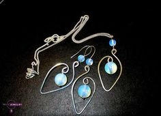 Silver earrings with silver necklace.