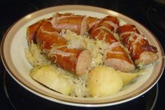 Ingredients  2 (14 ounce) cans sauerkraut, undrained (or 1 (2 pound) bag)  5 or 6 potatoes, peeled and cut into large chunks  1 cup water  1 pound Polish sausage, cut into chunks (could use smoked sausage)  1 teaspoon caraway seeds  1