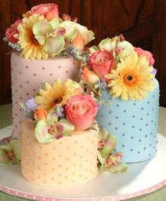 Love the different colored pastel cakes with the Swiss dots, fresh flowers are pretty on top, just don't like the ones that they chose.