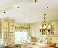 Layered Kitchen Lighting, don't really care for the lighting per say, but do like the cabinets and decor!