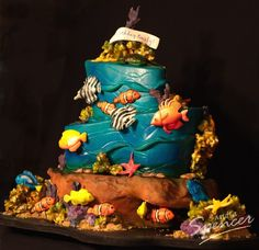 topsy turvy cake with sugar fish and coral reef