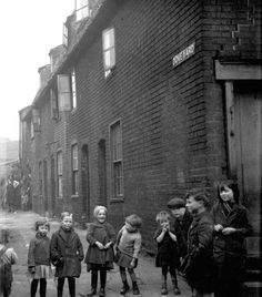 This photograph of Dove Yard gives a good idea of life in ÒThe PotteriesÓ area of Ipswich. Dove Yard was off Rope Walk running parallel with Dove Street. (Photo by Guy Maynard courtesy Colchester and Ipswich Museum Service. Old Photos, Vintage Photos, Kindred Spirits, Do You Remember, Street Photo, The Neighbourhood, Guy, Photograph, Street View