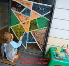 """washable """"stained glass"""" painting - Tempera paint mixed with dish soap painted in making tape-divided segments."""