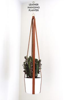 How to make a leather hanging planter www.apairandasparediy.com barefootstyling.com