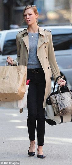 Simply chic: For her busy Friday running about town, the 21-year-old donned a pair of high waisted black skinny jeans cropped just above her...
