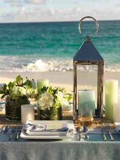 beach #wedding table in shades of aqua, light blue  and soft lime green with pretty lantern and candles