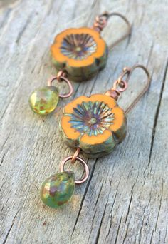 """Orange Picasso flower cut Czech glass with small spring green glass teardrop that perfectly accents the flowers finish. These small earrings are approx 1.5"""" in length."""