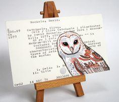 An owl on an owl card catalog card.  Love it.