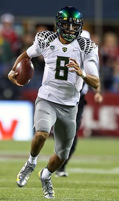 Oregon #Ducks' Marcus Mariota leads the Pac-12 in completion percentage and has thrown 18 touchdowns to just five interceptions.