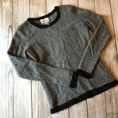 Banana Republic Wool/Cashmere Blend Sweater Beautiful gray sweater with black trim - very soft me warm - button detail on left shoulder - 49% nylon/44% wool/7% cashmere - excellent condition NO TRADES Banana Republic Sweaters Crew & Scoop Necks