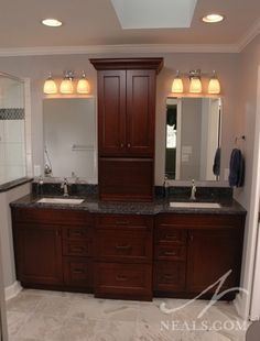 Double vanity with center storage tower Bathroom