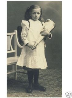 Vintage photo of a little German girl on her first school day