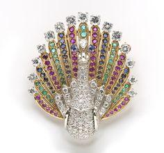 A ruby, sapphire, emerald and diamond peacock pendant/brooch