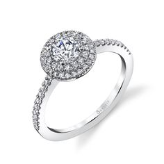 Style# S1086P Double-Halo Petite Diamond Engagement Ring - This breathtaking diamond engagement ring features a 0.5 carat round petite center stone nestled in a round shaped halo with not one, but two rows of dazzling diamonds and held on a shank with more diamonds cascading half way down the sides. https://www.sylviecollection.com/double-halo-petite-diamond-engagement-ring-s1086p