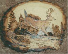 Deer Jumping Creek wood burning art