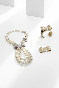 Chanel pearls, gold bows, wedding jewelry, fabulous.
