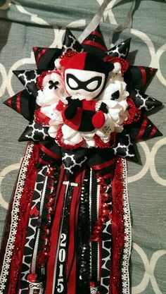 Harley quinn themed. Large single flower necklace homecoming mum.  anniesmums.wix.com/mums-garters