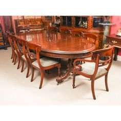 A superb antique Victorian dining set comprising an antique mahogany dining table and a set of 10 bespoke dining chairs. Buy Dining Table, Mahogany Dining Table, Table 19, Table And Chair Sets, Dining Chairs, Victorian Dining Sets, Piano Stool, Vanity Box, Brown Wood