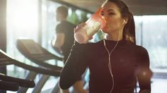 Attractive caucasian girl is drinking a protein shake drink next to a treadmill in the sport gym. shot on red cinema camera in (uhd). Food To Gain Muscle, Muscle Building Foods, Bra Video, Video Clip, Japanese Couple, Caucasian Girl, Sport Treiben, Cinema Camera, 4k Uhd