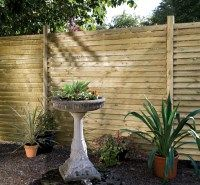 Louvre Decorative Wooden Fence Panel. A strong and contemporary looking fence design that can be used as a traditional panel or as a sun screen on a pergola. Dimensions of 1.8 x 1.8m £85.51. #DecorativeFencePanels #GardenFencePanels #AWBS