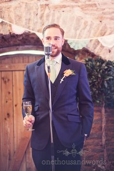 Grooms speech with retro microphone. Photography by one thousand words wedding photographers www.onethousandwords.co.uk
