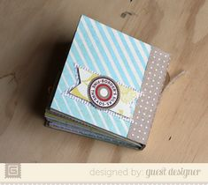 4x4 Mini book- 3 pieces of cardboard (2-4*4 1-4*1+ masking tape) covered w/ Basic Grey's fact or fiction.