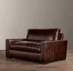 Oversized leather chair for living room paired with ottoman