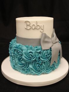 Hosting a baby shower, or welcoming a baby boy of your own? Celebrate the new addition with this adorable cake! Buttercream base with piped buttercream rosettes and fondant bow by Party Flavors Custom Cakes in Orlando, Florida. http://www.orlandocustomcakes.com/