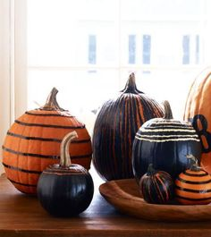 Give a tabletop or mantel some Halloween flair with these stylish painted pumpkins. Technique: http://www.midwestliving.com/holidays/halloween/easy-no-carve-pumpkin-decorating/page/1/0