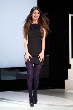 Victoria Justice outfit: black dress, colored tights, heels #fall