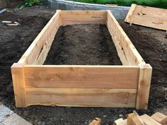 """Juniper raised bed built with 2""""x8"""" lumber and 4""""x4"""" posts with a peaked detail added for visual interest"""