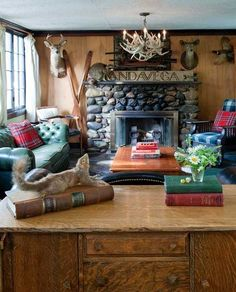 Get rid of all the dead animals and the lame skiis against the wall and this is totally me!  Warm color on the walls, old furniture, books, plaid, leather, stone... yep, totally.