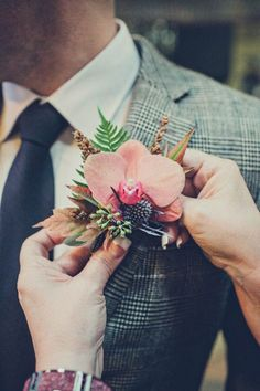 Amazing orchid boutonniere | Photo by Paco & Betty