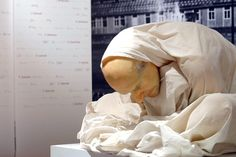 """""""Man with Sheet"""" created by Australian artist Ron Mueck crouches silently as a testiment to the medical professions shame at the Medical History Museum April 29, 2003 in Berlin."""