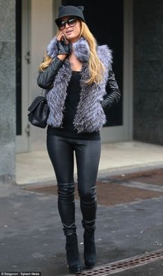 Paris Hilton wearing Chanel 2.55 Bag, Dita Paradis Sunglasses in Black, Rag & Bone the Reverse Jodhpur Leather Pants, Cassin Lou Leather Inset Silver Fox Fur Vest, IRO Luciana Knit Collar Moto Leather Jacket, Chanel Leather Logo Chained Gloves, Helene Berman Cat Ears Hat and Walter Steiger Perforated Ankle Boot