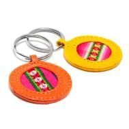 Bright Leather Keychain : Made from hand-painted leather and Peruvian textiles, artisans cut, dye and hand-stitch each individual leather keychain.
