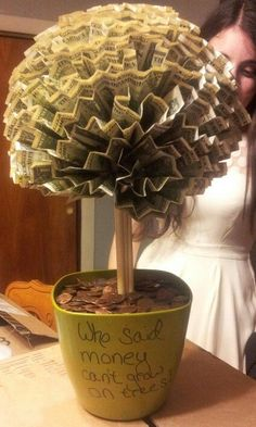 Money tree DIY 100 1 bills A few rolls of pennies 5 or 6 skewers Pins for sewing A foam ball A pot for a potted plant Get the foam base in the pot Add 5 or so skewers. Creative Money Gifts, Gift Money, Folding Money, Money Cake, Money Origami, Money Trees, Cute Gifts, Diy Kid Gifts, Graduation Gifts