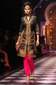 Raghavendra Rathore at India Bridal Fashion Week. Black embroidered jacket with pink pants.