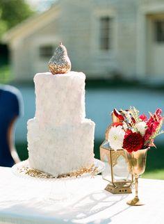 gold pear cake topper #caketoppers #whitecake #weddingchicks http://www.weddingchicks.com/2013/12/20/red-and-navy-wedding-ideas/