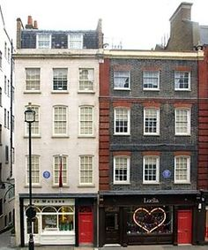 The exterior of 23 and 25 Brook St Mayfair, now Handel House Museum, showing the English Heritage blue plaques recognising the homes of Jimi Hendrix (1968-1969) and George Frideric Handel (1723-1759).