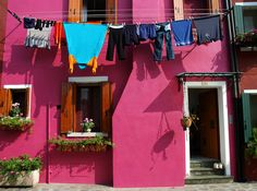 Laundry and pink building in Burano, Venice.