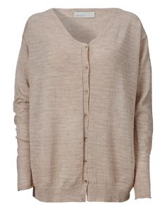 Lightweight v-neck cardigan with a loose fit. Wide ribbed neck line and metal buttoned closure at the front. The sleeves have slightly rolling edges from the finishing, raw rib detail on the sleeves. Subtle, soft knitted structure.  Styled with Safran pant.